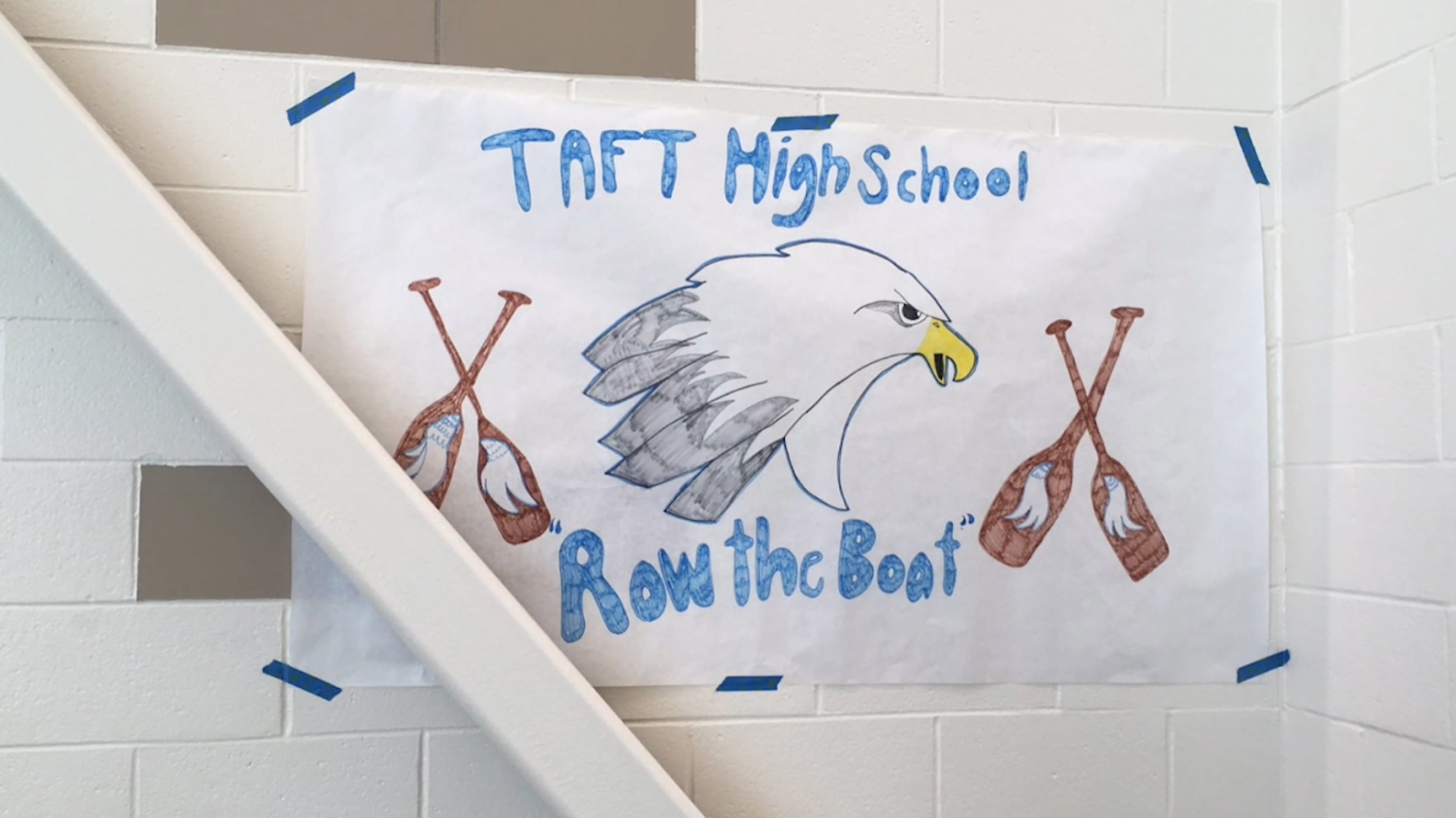 Handmade poster supporting the girls swimming team.