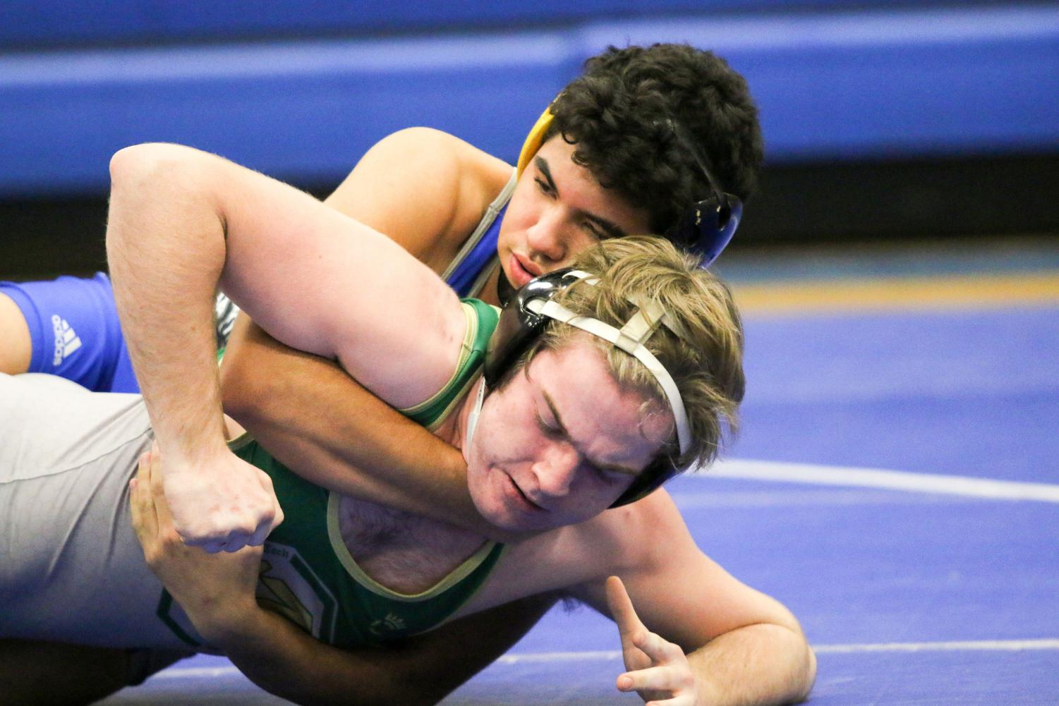 In the 170-lb weight class, Brandon Warden, takes down his opponent from Lane Tech. Taft beats Lane 66-17 in overall team points.
