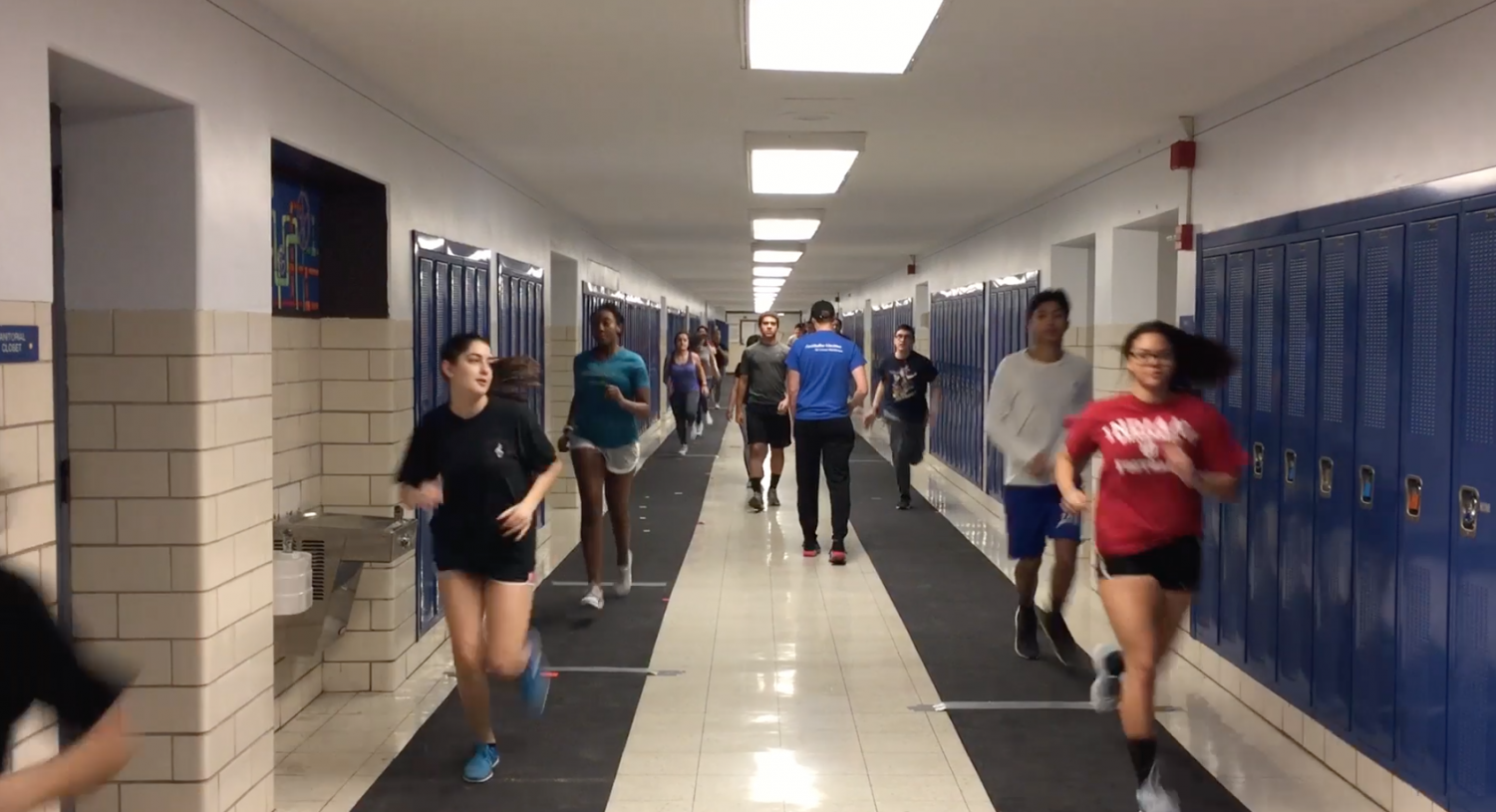 Track and Field members practicing in the halls.