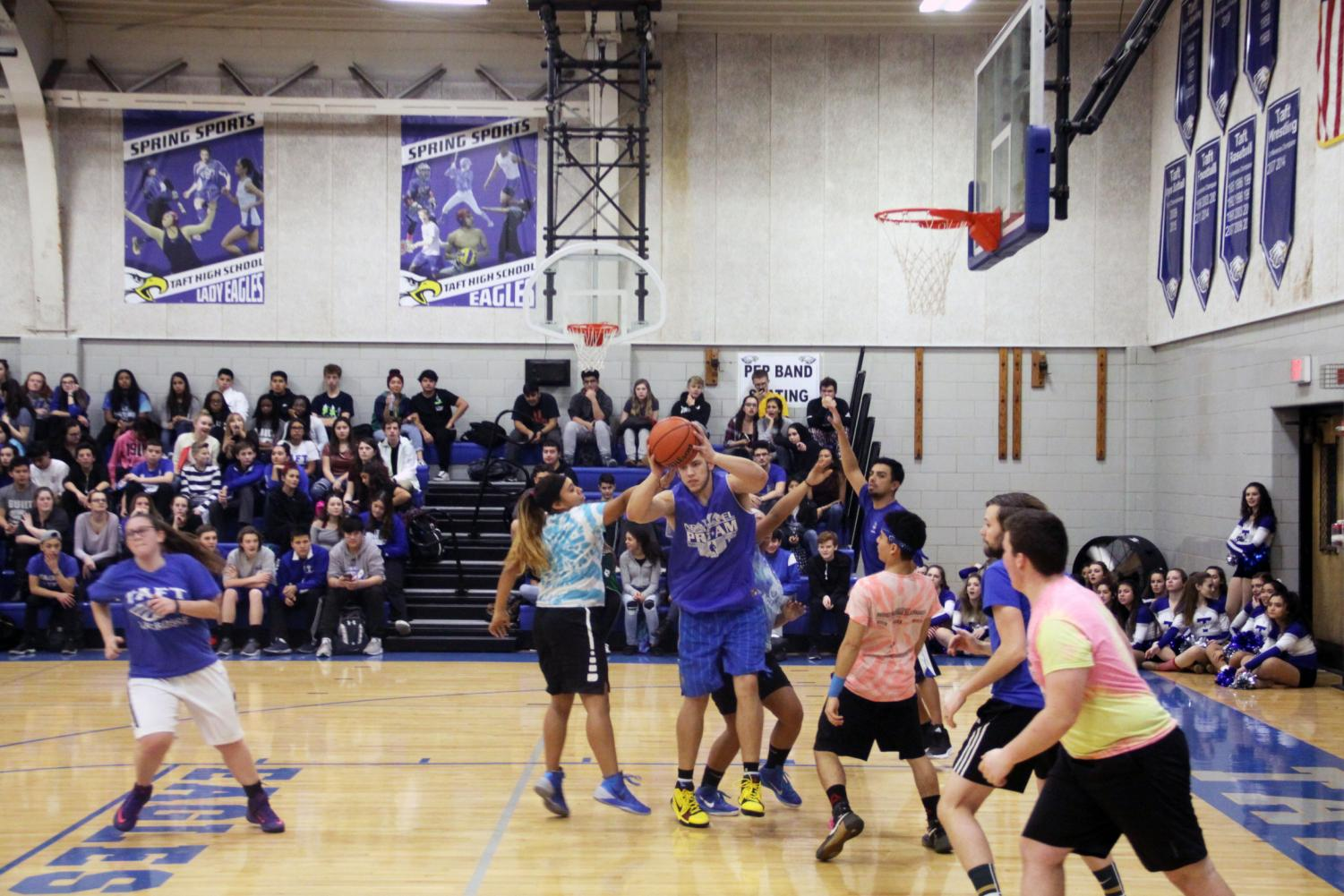 The Taft student Eagles take on the faculty during a Pink Out basketball game.