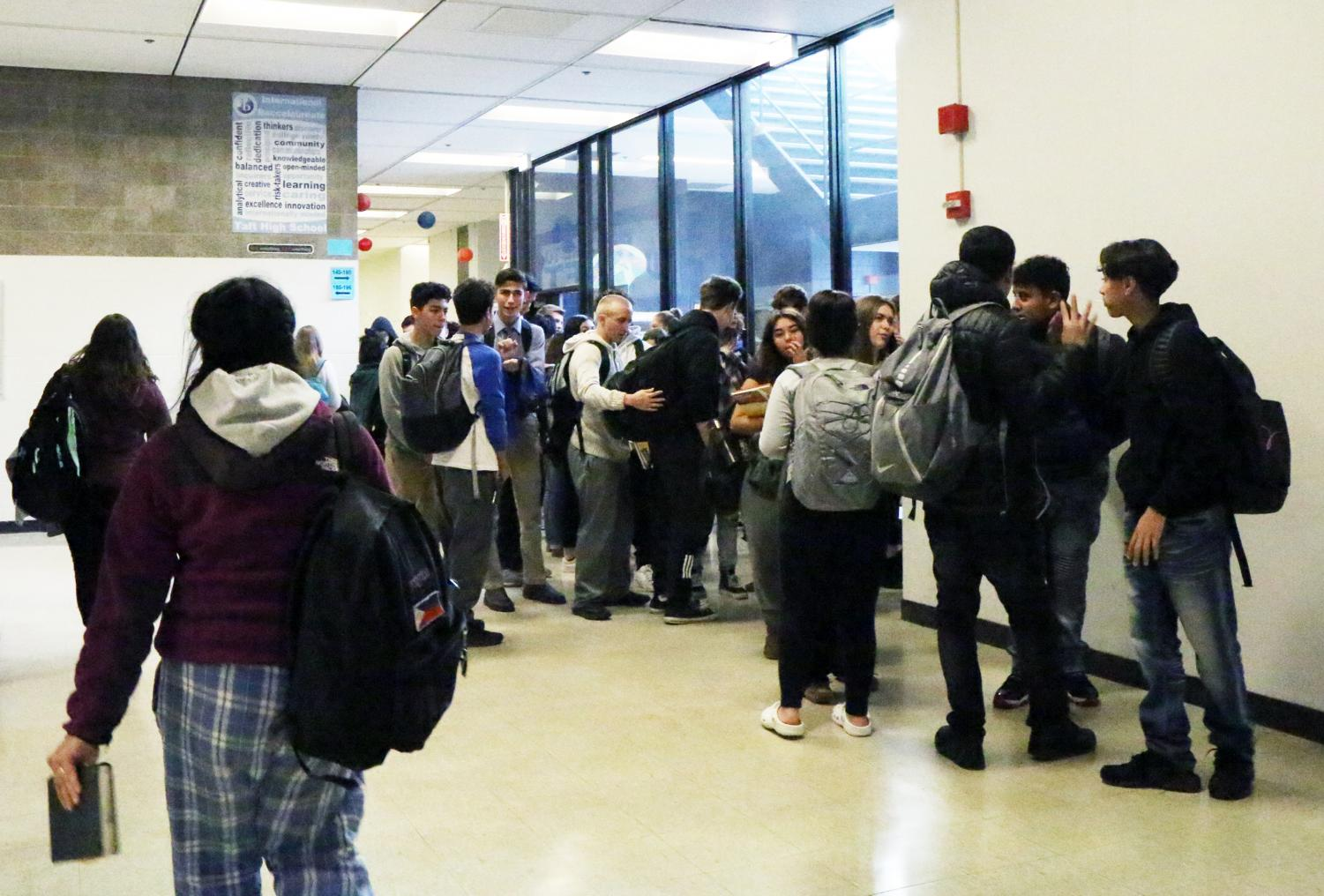 Students rush to class after hearing the late bell.