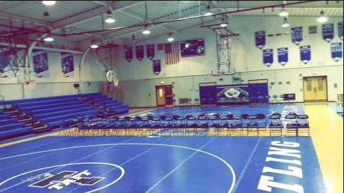Taft Eagles prepare the main gym before every wrestling match.