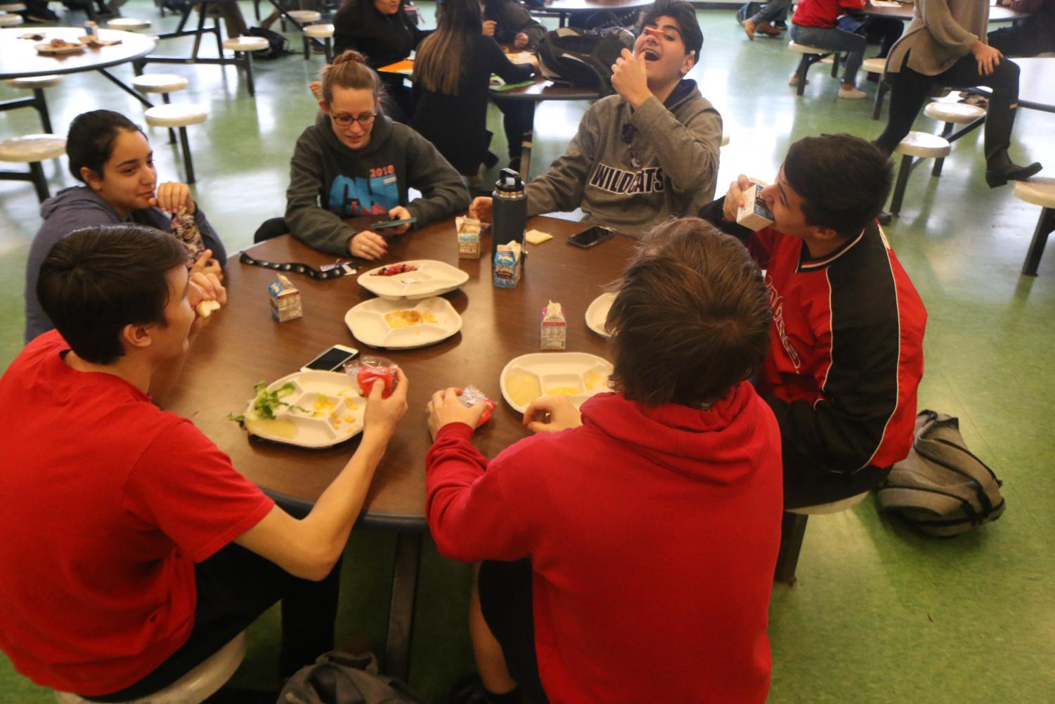 Student conversing in the lunchroom.