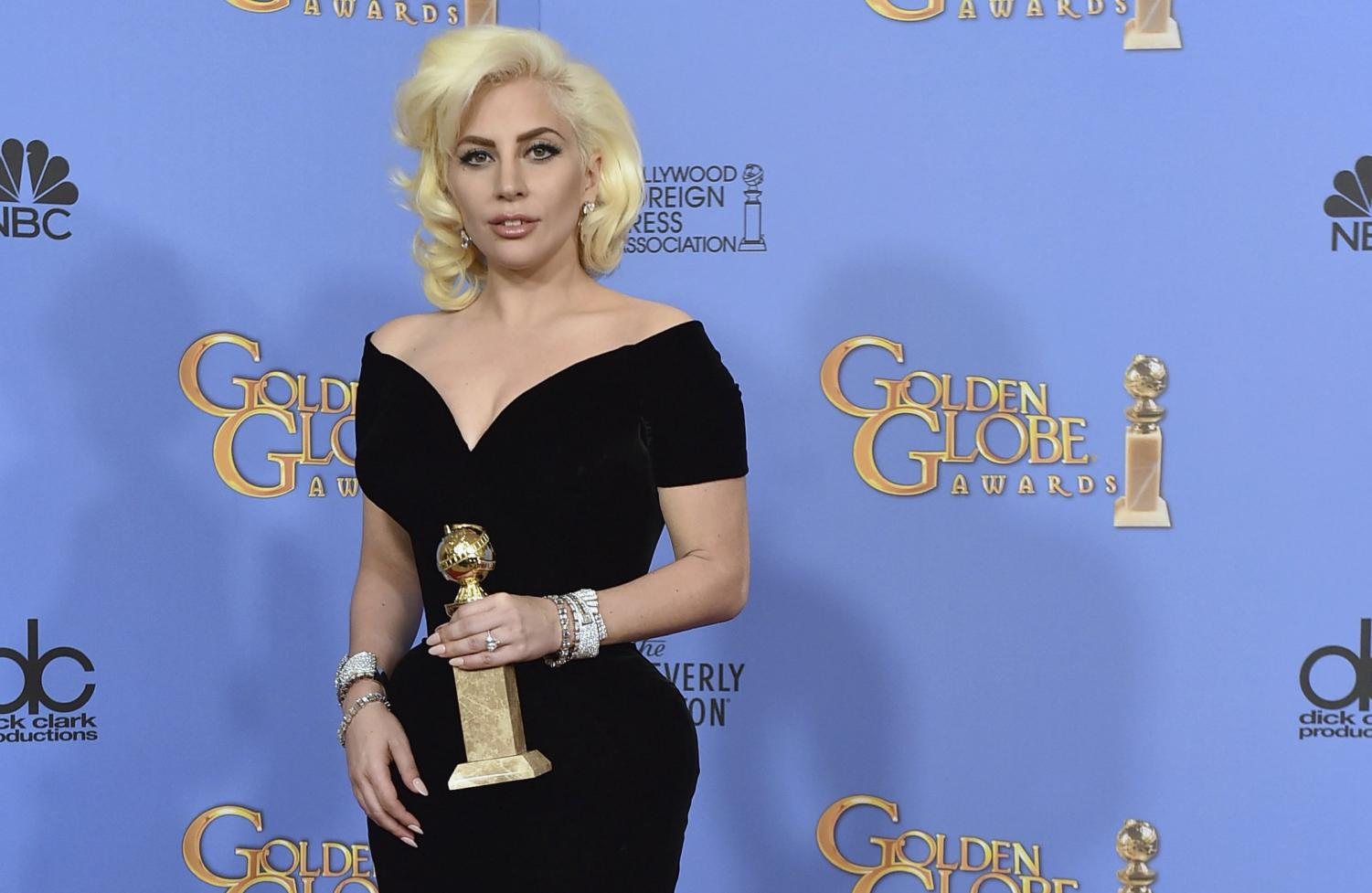 Lady Gaga poses for a picture after winning a Golden Globe Award.