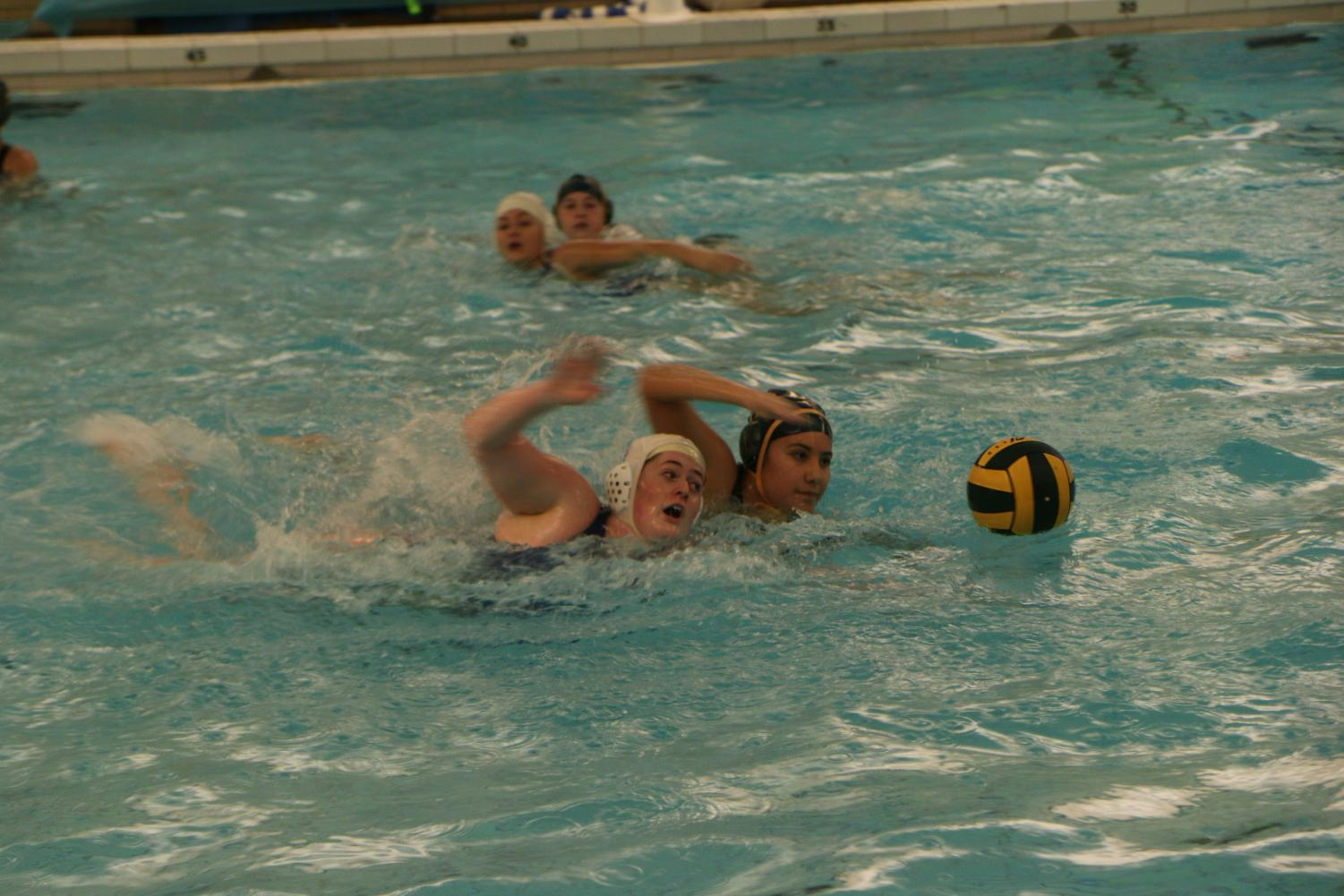 Ashling Staunton goes for the swim-off against a rival player. Whoever gets to the ball first would be in possession.