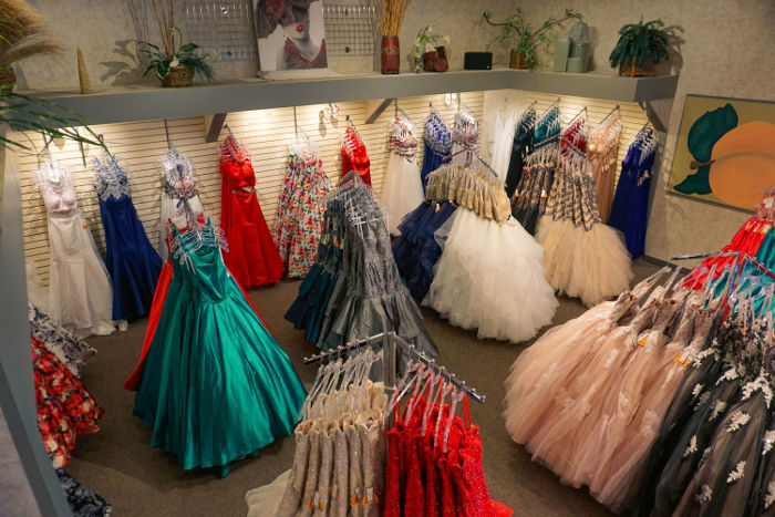 Trendy+prom+dresses+line+the+walls+at+Chicago+boutique%2C+Peaches.+