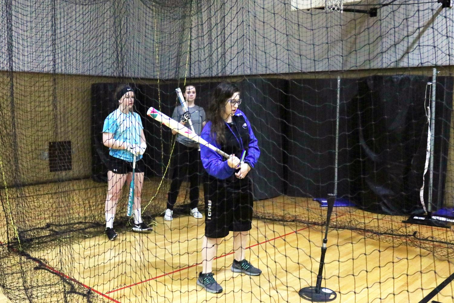New Coach Rothbart demonstrates to her freshmen/sophomore team valuable softball skills.