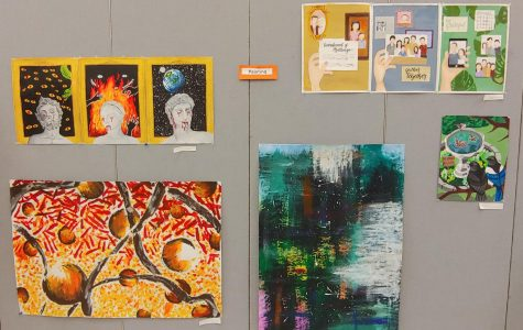 Multiple anonymous painting artworks, along with several other types of art are presented at the pop up art show.  Photographer Yasmine Soria.