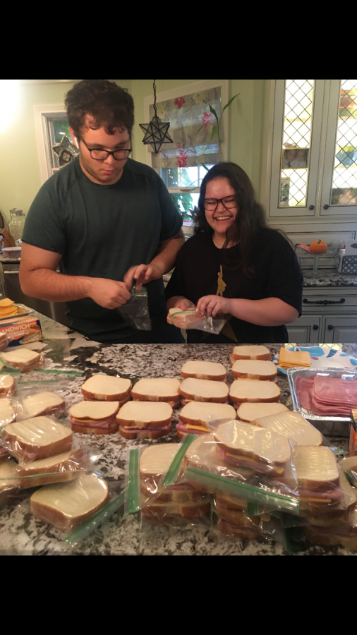 Andreu and her cousin, Jack Minasian, bagging ham and cheese sandwiches that will later be taken to a shelter and   given to the homeless.                    Photo by Jessica Andreu