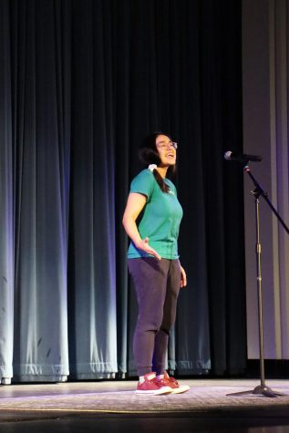 "School winner Catherine Herrera recites her poem ""The Kiss"" by Robert Graves. <br /> Photographer Yasmine Soria."