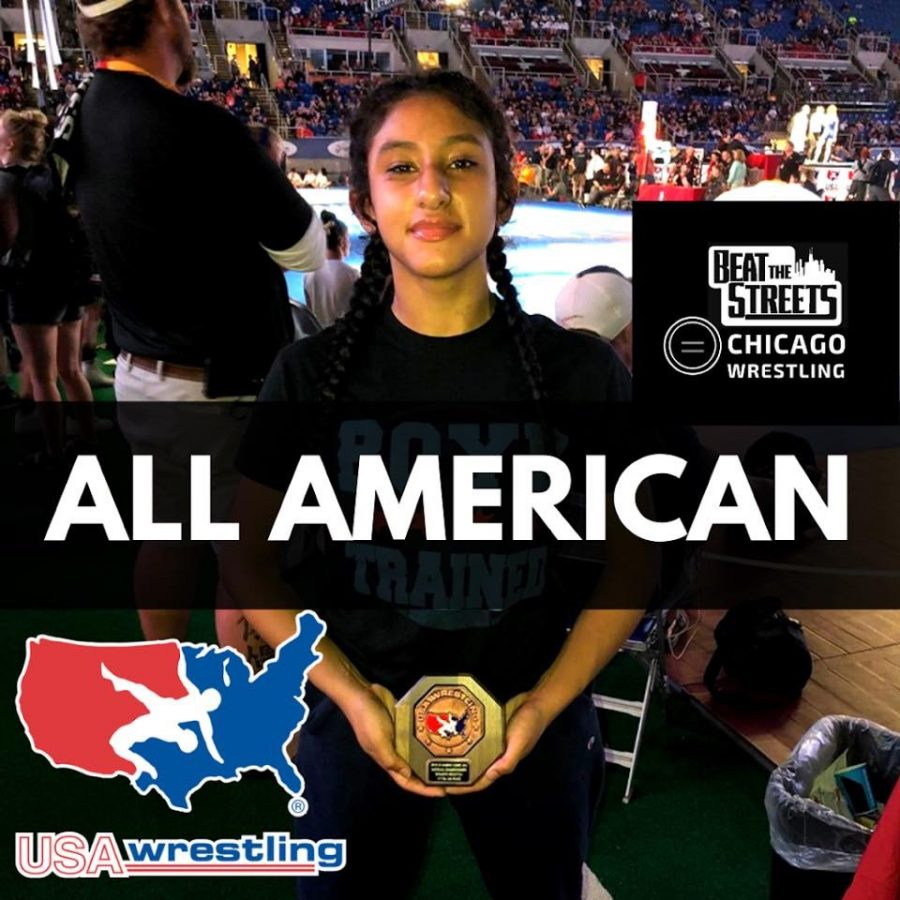 Del Toro poses proudly with her All-American trophy at Beat the Streets Chicago. Photo by https://www.btschicago.org/kaila-achieves-all-american-at-fargo/