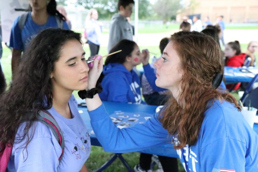 Students decked in Taft gear enjoy the activities that Taft Friday Lights provided such as face painting and air football.
