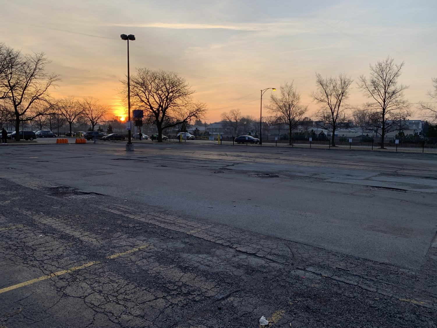The parking lot sits empty as the sun rises at 7:00 a.m. Photographer  Katarina Ilic.