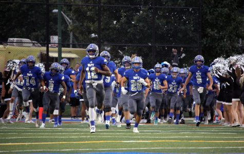 The Eagles make their entrance in their first home game on a new turf field at Taft for Friday Night Lights. Photographer Xzavier Aguilar.