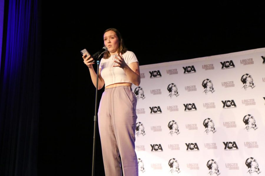 Senior+Julia+Soulsby+recites+her+own+poem+titled++%E2%80%9CThrowing+yourself+a+pity+party%E2%80%9D+at+the+Louder+Than+a+Bomb+invitational.+%0APhotographer+Anny+Martinez.