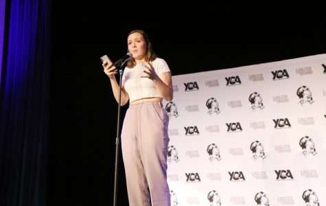 """Senior Julia Soulsby recites her own poem titled  """"Throwing yourself a pity party"""" at the Louder Than a Bomb invitational.  Photographer Anny Martinez."""