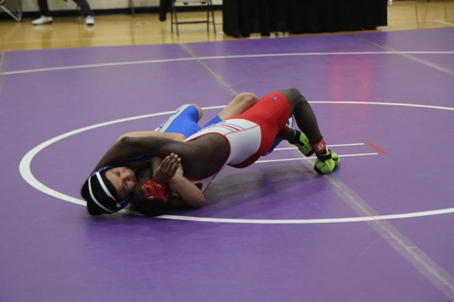 Julian Valtierrez dominating his opponent with a winning pin.  Photographer Melissa Parra.