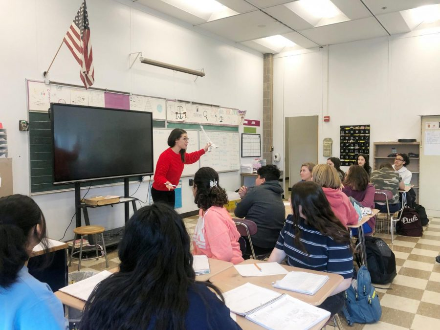 Kleinhample enthusiastically teaches her French class, excited for the event to happen next spring break.       Photographer Melody Resto.